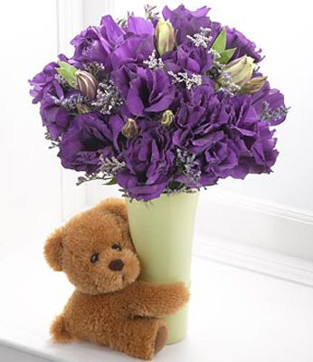 blue flowers with teddy bear