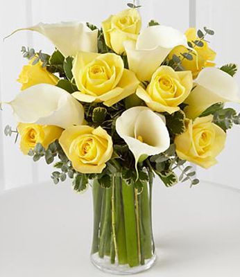yellow roses and white calas