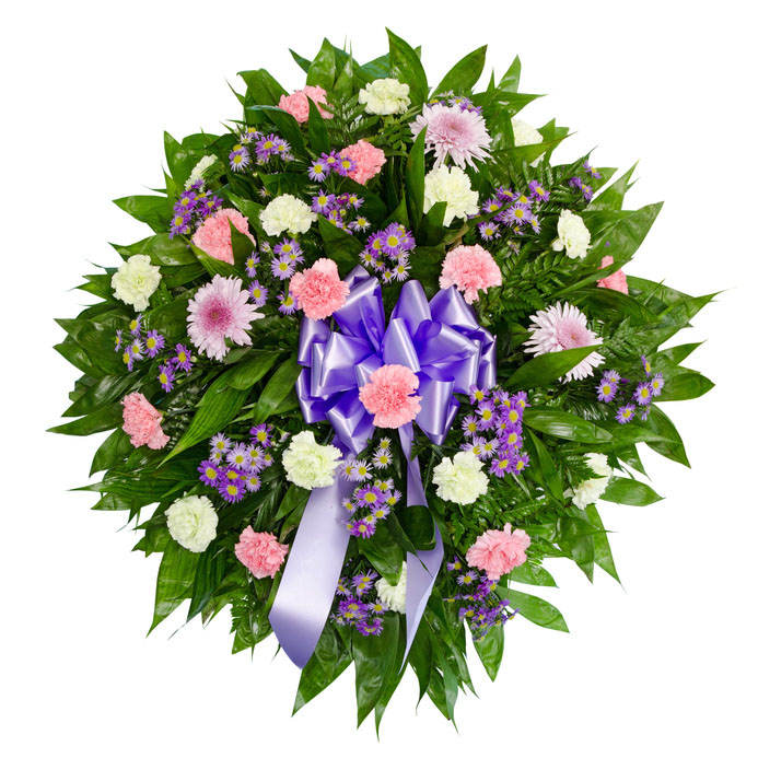 funeral wreath with carnations and daisies