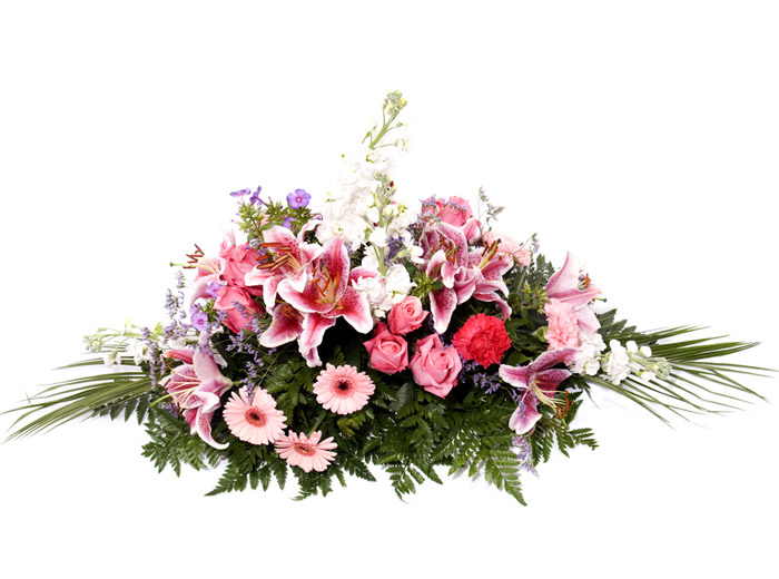 funeral spray with pink lilies
