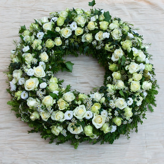 funeral wreath with roses and mixed white flowers