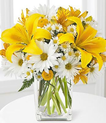 yellow lilies and daisies